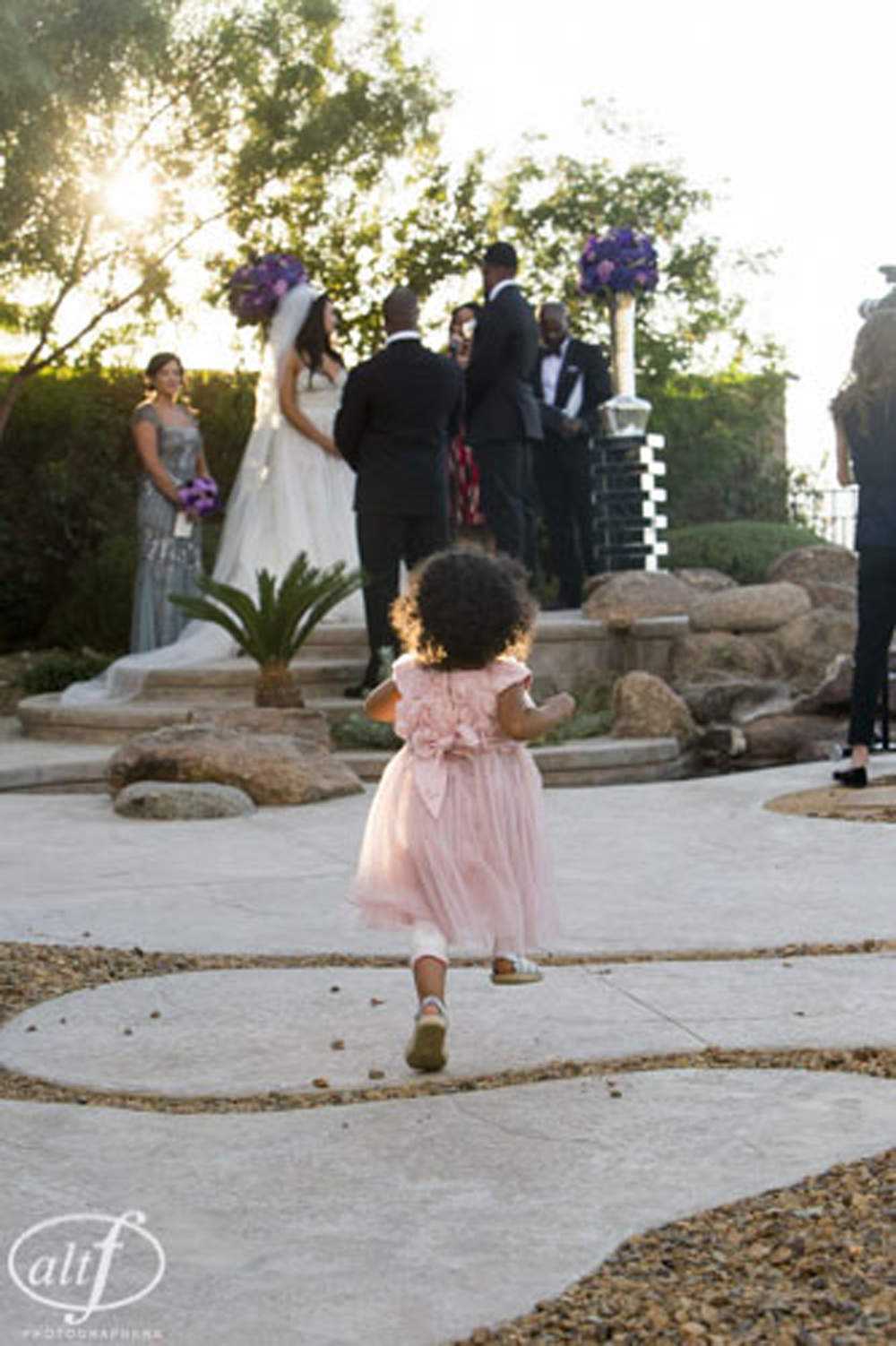 Flower girl runs away from the ceremony. Pre-wedding photos of the bride and the groom, without seeing each other. Las Vegas Wedding Planner Andrea Eppolito.  Image by Altf.com.