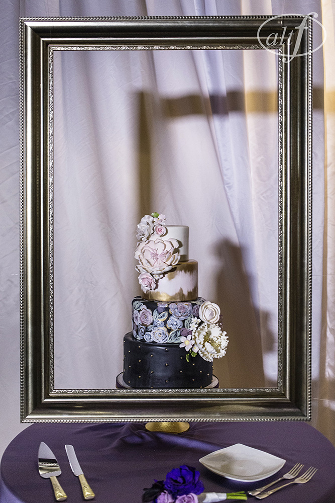 The wedding cake is a work of art hung behind a frame. Pre-wedding photos of the bride and the groom, without seeing each other. Las Vegas Wedding Planner Andrea Eppolito.  Image by Altf.com.Cake by Peridot Sweets.
