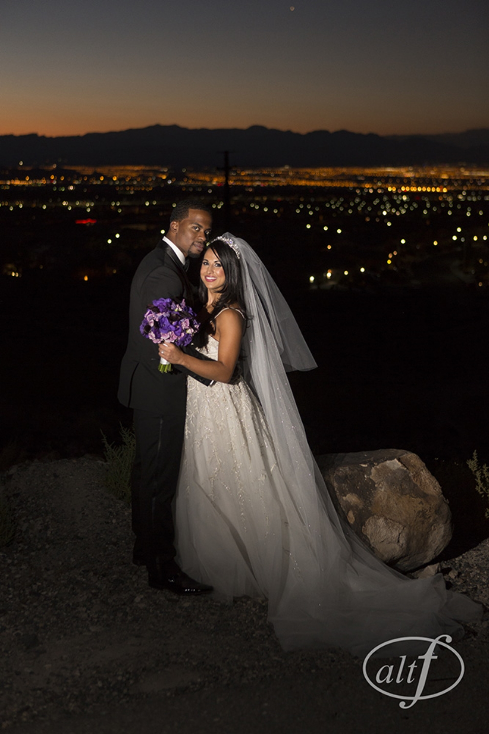 Couple wedding portrait in front of Vegas skyline.  Las Vegas Wedding Planner Andrea Eppolito.  Image by Altf.com.