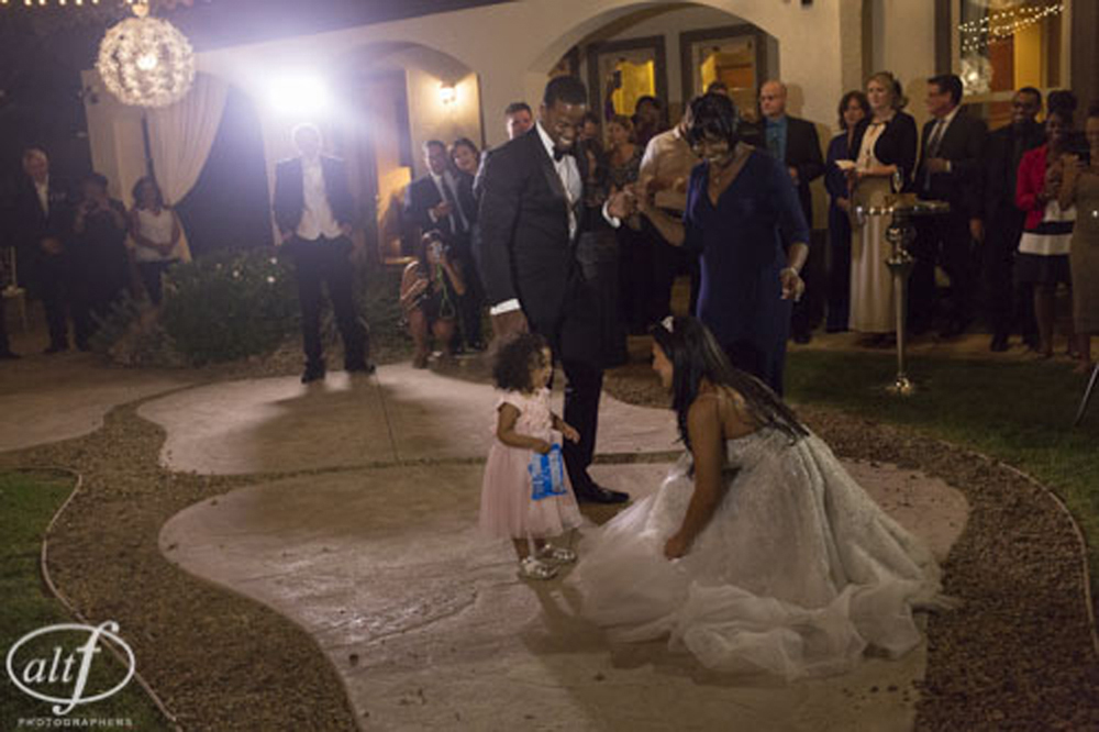 The bride and groom dance with their daughter. Las Vegas Wedding Planner Andrea Eppolito.  Image by Altf.com.