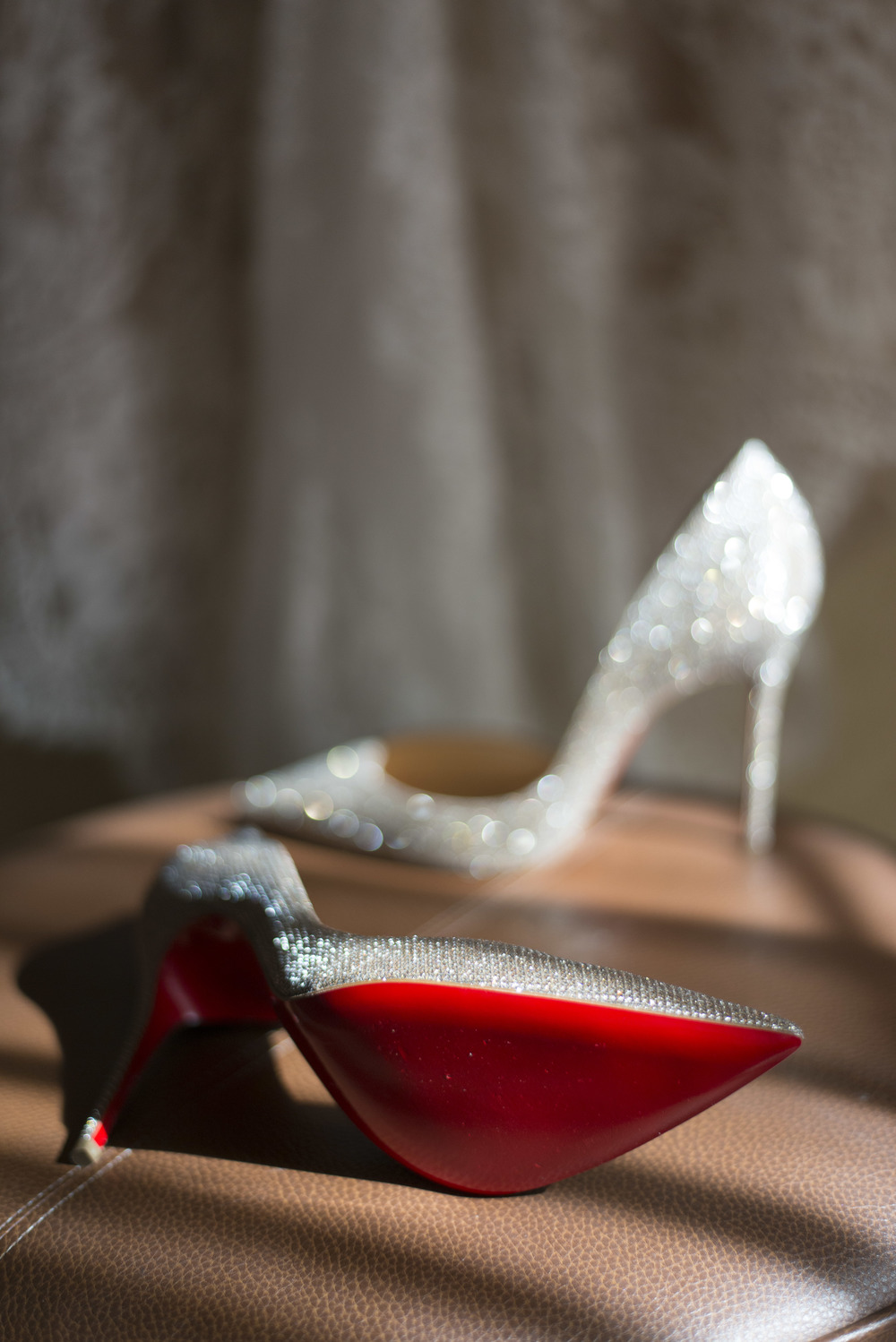Sexy Red Bottom Wedding Shoes.     Vendor Credits: Las Vegas Wedding Planner:  Andrea Eppolito Events  |  Photography:  Altf Photography  |  Videography: Something New Films  |  Shoes:  Christian Louboutin