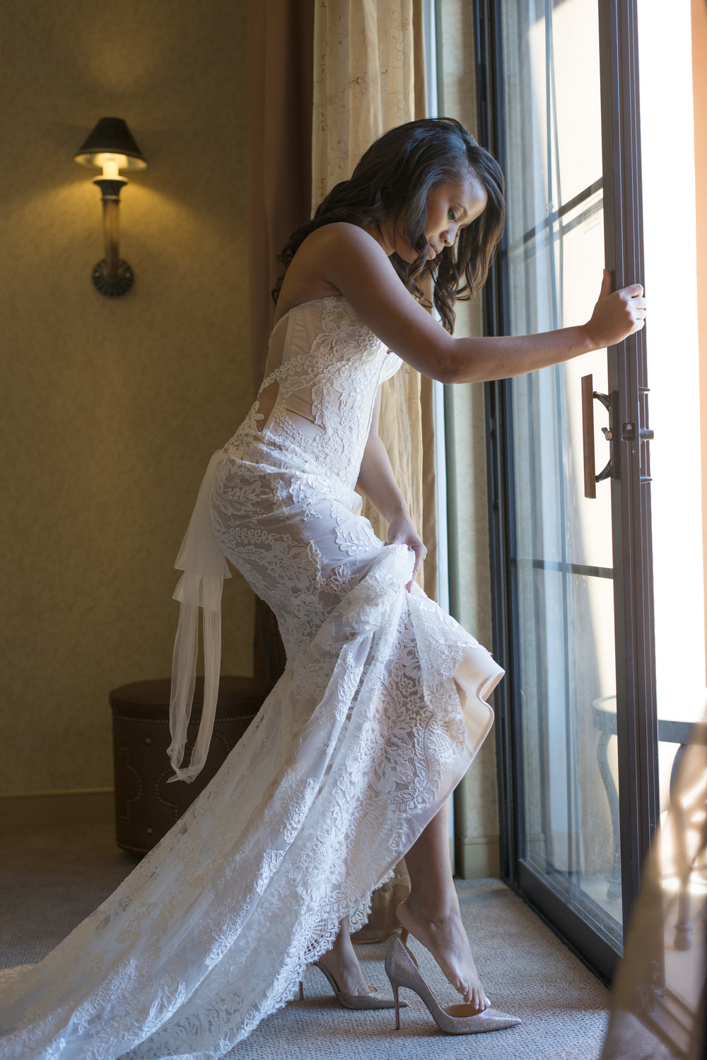 Corset Back P'Nina Tornai Wedding Dress from Kleinfeld.     Vendor Credits: Las Vegas Wedding Planner:  Andrea Eppolito Events |  Photography:  Altf Photography  |  Wedding Gown: P'Nina Tornai  |  Veil: Kleinfeld New York  |  Shoes:  Christian Louboutin  |  Tuxedo:  Men's Warehouse