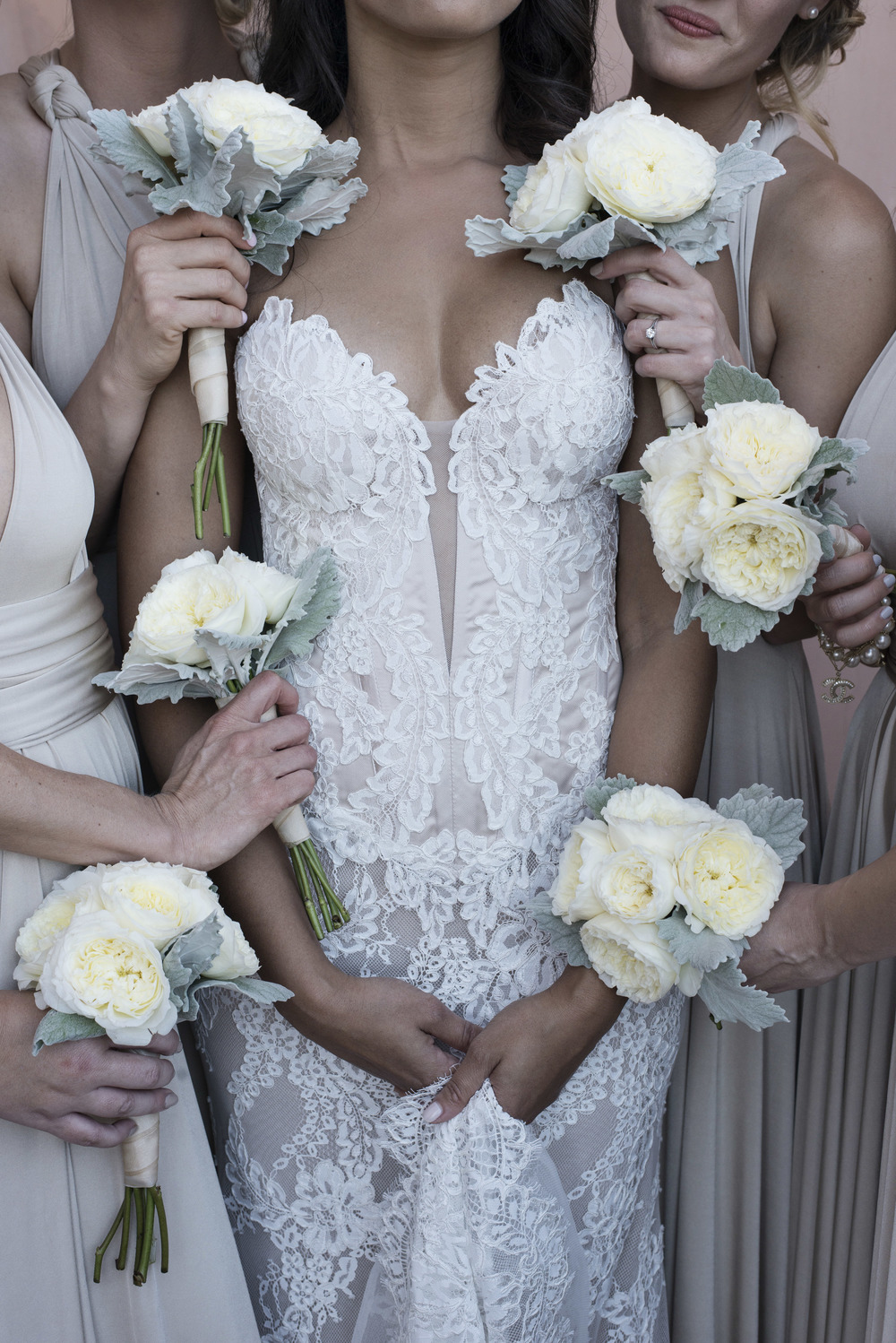Bridesmaids carried small white ranunculus.  Bride wore a lace P'Nina Tornai Wedding Dress by P'Nina Tornai.   Vendor Credits: Las Vegas Wedding Planner:  Andrea Eppolito Events  |  Venue: The Westin Lake Las Vegas  |  Floral & Decor:  Flora Couture |  Photography:  Altf Photography