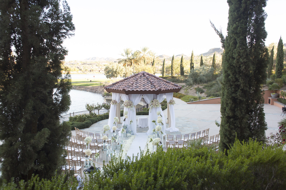 Modern and romantic lakeside wedding.  Vendor Credits: Las Vegas Wedding Planner:  Andrea Eppolito Events  | Venue: The Westin Lake Las Vegas  |  Floral & Decor:  Flora Couture |  Photography:  Altf Photography  |  Videography: Something New Films  | Wedding Cake:  Peridot Sweets  |  Beauty by:  Make Up in the 702  |  Wedding Gown: P'Nina Tornai  |  Veil: Kleinfeld New York  |  Shoes:  Christian Louboutin  |  Tuxedo:  Men's Warehouse