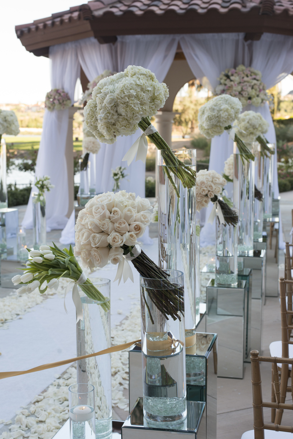 Aisle lined with Jeff Leatham style Centerpieces.  Vendor Credits: Las Vegas Wedding Planner:  Andrea Eppolito Events  | Venue: The Westin Lake Las Vegas  |  Floral & Decor:  Flora Couture |  Photography:  Altf Photography  |  Videography: Something New Films  | Wedding Cake:  Peridot Sweets  |  Beauty by:  Make Up in the 702  |  Wedding Gown: P'Nina Tornai  |  Veil: Kleinfeld New York  |  Shoes:  Christian Louboutin  |  Tuxedo:  Men's Warehouse