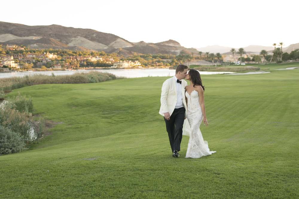 Wedding photos on golf course.  Vendor Credits: Las Vegas Wedding Planner:  Andrea Eppolito Events  | Venue: The Westin Lake Las Vegas  |  Floral & Decor:  Flora Couture |  Photography:  Altf Photography  |  Videography: Something New Films  | Wedding Cake:  Peridot Sweets  |  Beauty by:  Make Up in the 702  |  Wedding Gown: P'Nina Tornai  |  Veil: Kleinfeld New York  |  Shoes:  Christian Louboutin  |  Tuxedo:  Men's Warehouse