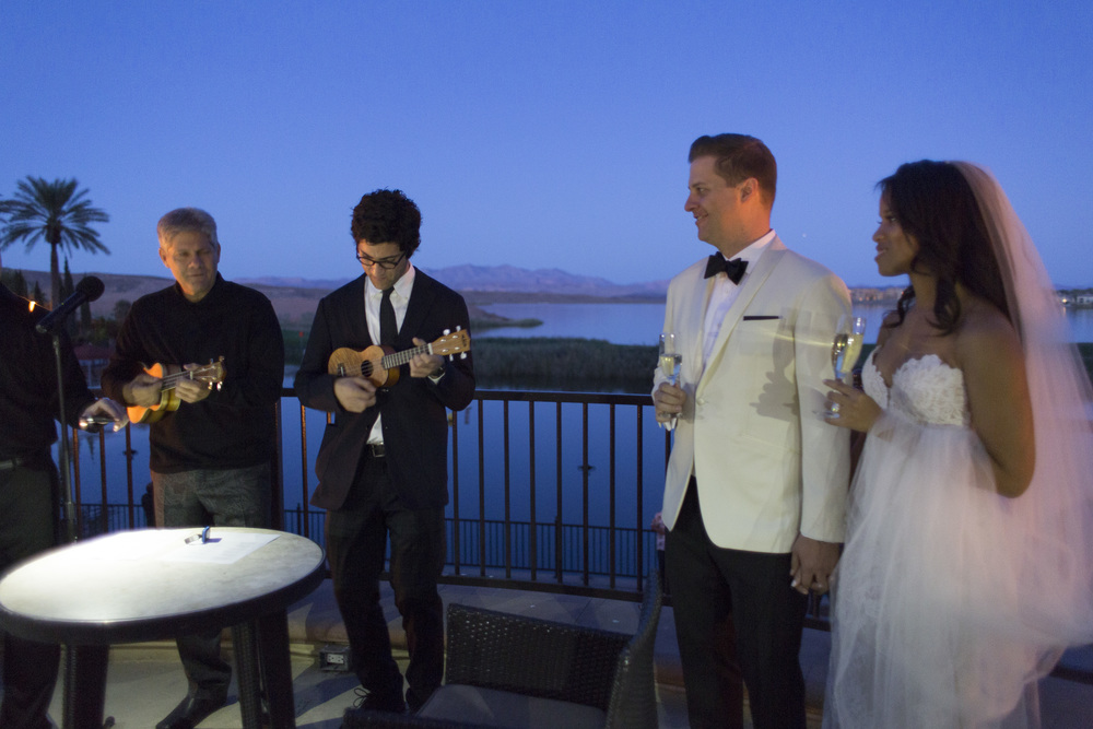 Family plays music.  Vendor Credits: Las Vegas Wedding Planner:  Andrea Eppolito Events  | Venue: The Westin Lake Las Vegas  |  Floral & Decor:  Flora Couture |  Photography:  Altf Photography  |  Videography: Something New Films  | Wedding Cake:  Peridot Sweets  |  Beauty by:  Make Up in the 702  |  Wedding Gown: P'Nina Tornai  |  Veil: Kleinfeld New York  |  Shoes:  Christian Louboutin  |  Tuxedo:  Men's Warehouse
