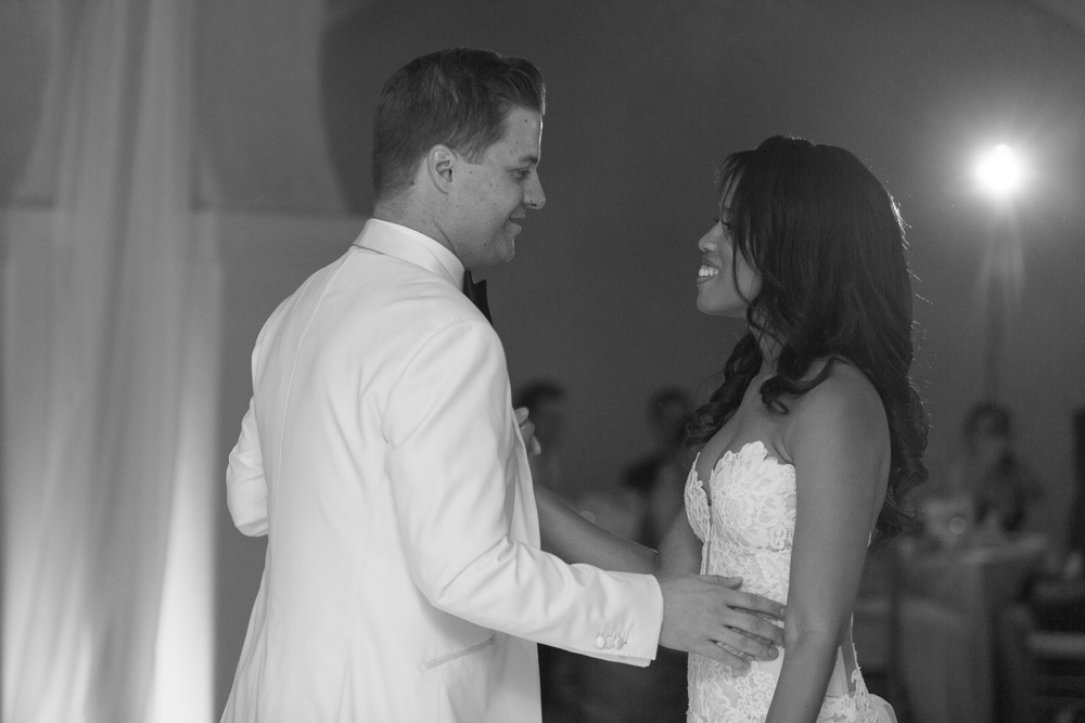 Black and White image of wedding first dance.  Vendor Credits: Las Vegas Wedding Planner:  Andrea Eppolito Events  |  Ceremony:  Andalusian Gardens at The Westin Lake Las Vegas  |  Reception:  Baraka Ballroom at The Westin Lake Las Vegas  |  Floral & Decor:  Flora Couture |  Photography:  Altf Photography  |  Videography: Something New Films  | Wedding Cake:  Peridot Sweets  |  Beauty by:  Make Up in the 702  |  Wedding Gown: P'Nina Tornai  |  Veil: Kleinfeld New York  |  Shoes:  Christian Louboutin  |  Tuxedo:  Men's Warehouse