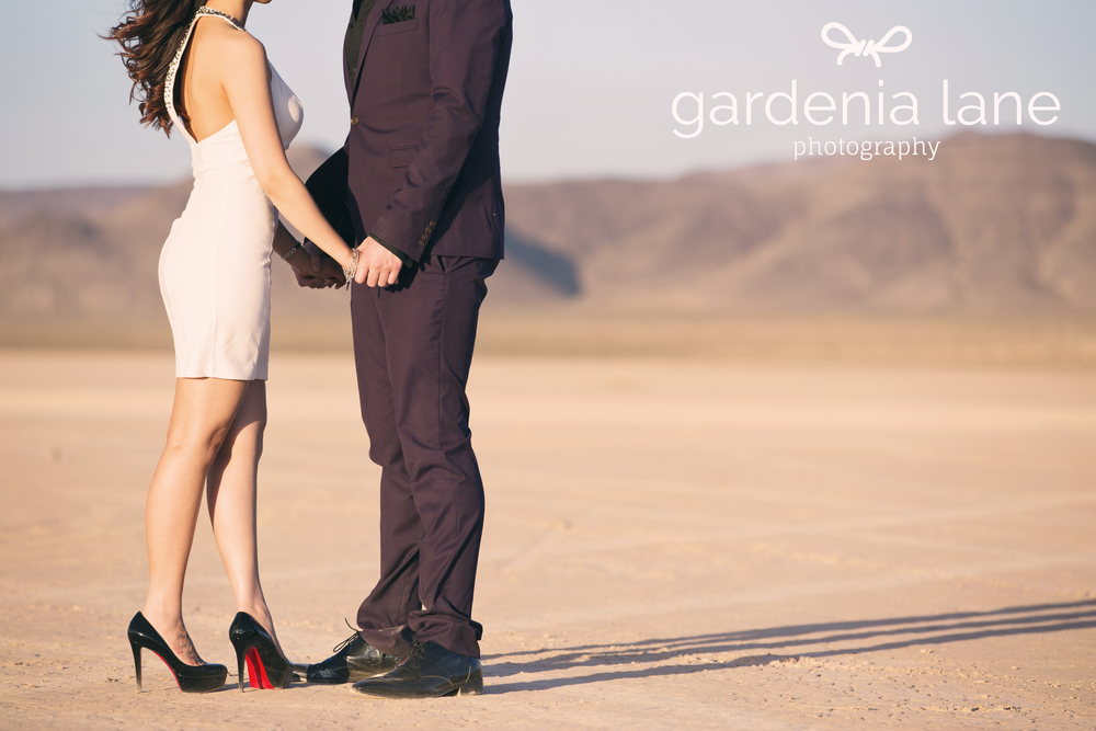 Red bottom louboutin shoes in Las Vegas engagement photos.  Las Vegas Wedding Planner Andrea Eppolito is handling Sharon and Lane's destination wedding at the SLS.    Engagement photo by   Gardenia Lane.  Sexy Black adn Whi