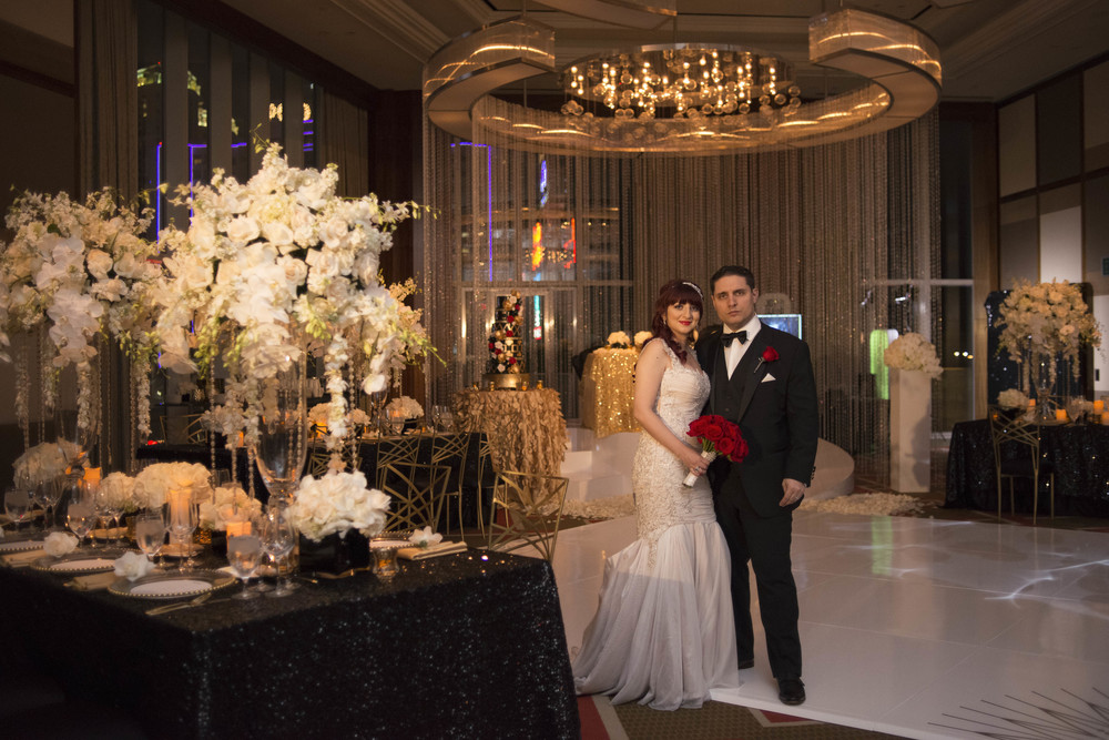 Anna and Angelo were married at the Mandarin Oriental Las Vegas on Halloween. Their wedding was designed in to feel very old-Hollywood and was inspired by  The Great Gatsby .     Credits:  Wedding Planning and Event Design by  Andrea Eppolito Events  Luxury Las Vegas Wedding held at  The Mandarin Oriental .  Florals and Decor handled by  Destinations by Design .  Photography by  AltF Photography .  Wedding Film and Videography by  Pure Light Creative  with Music and Entertainment by  Mike Fox & Company .  Hair and Make Up by  Your Beauty Call .  Photo Booth and Video Screen by  The Joy Squad
