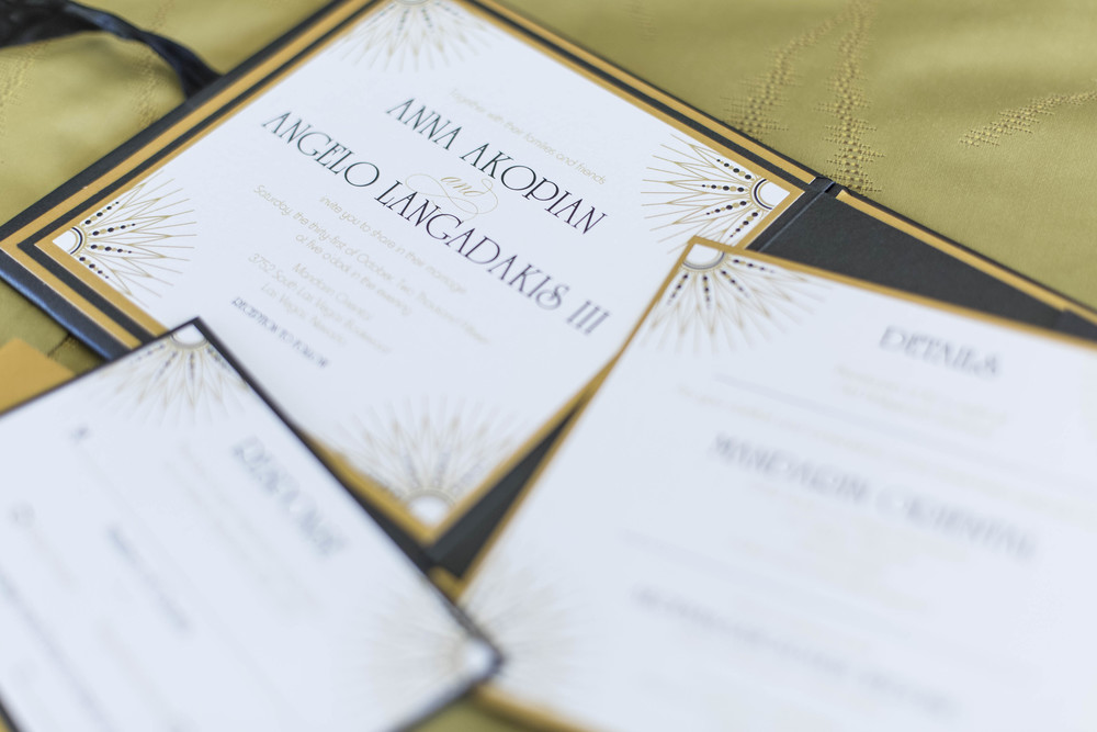 Black, white, and gold art deco invitations.     Credits:  Wedding Planning and Event Design by  Andrea Eppolito Events  Luxury Las Vegas Wedding held at  The Mandarin Oriental .  Florals and Decor handled by  Destinations by Design .  Photography by  AltF Photography .  Wedding Film and Videography by  Pure Light Creative  with Music and Entertainment by  Mike Fox & Company .  Hair and Make Up by  Your Beauty Call .  Photo Booth and Video Screen by  The Joy Squad .    Stationery by  Laura Damiano Designs .