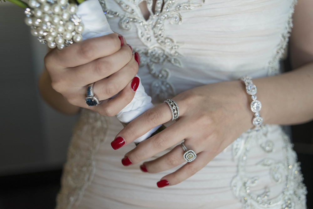 Red nails on a bride.  Credits:  Wedding Planning and Event Design by  Andrea Eppolito Events  Luxury Las Vegas Wedding held at  The Mandarin Oriental .  Florals and Decor handled by  Destinations by Design .  Photography by  AltF Photography .  Wedding Film and Videography by  Pure Light Creative  with Music and Entertainment by  Mike Fox & Company .  Hair and Make Up by  Your Beauty Call .  Photo Booth and Video Screen by  The Joy Squad .    Stationery by  Laura Damiano Designs .