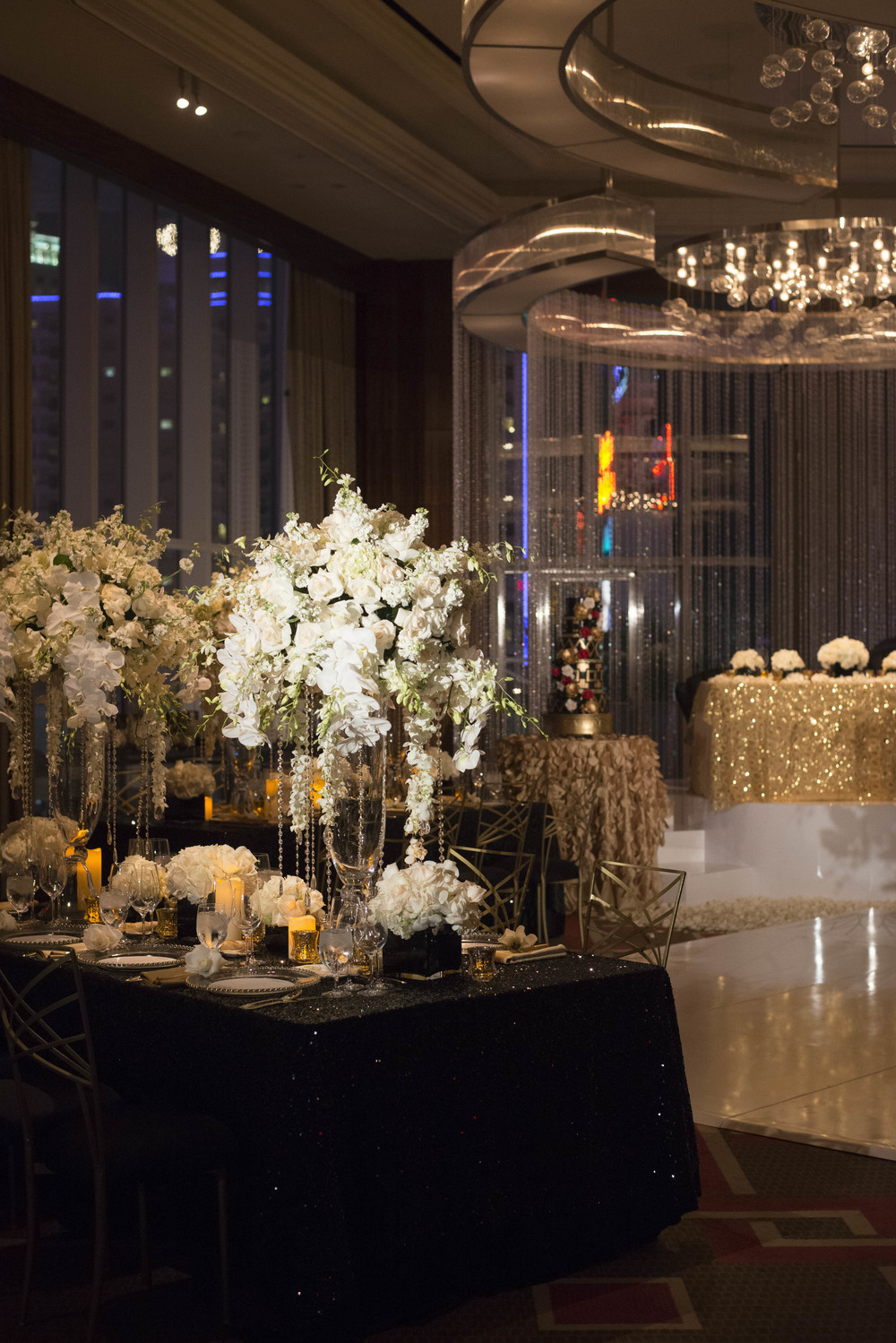 Black, white, and gold wedding.  Old Hollywood wedding.   Credits:  Wedding Planning and Event Design by  Andrea Eppolito Events  Luxury Las Vegas Wedding held at  The Mandarin Oriental .  Florals and Decor handled by  Destinations by Design .  Photography by  AltF Photography .  Wedding Film and Videography by  Pure Light Creative  with Music and Entertainment by  Mike Fox & Company .  Hair and Make Up by  Your Beauty Call .  Photo Booth and Video Screen by  The Joy Squad .    Stationery by  Laura Damiano Designs .