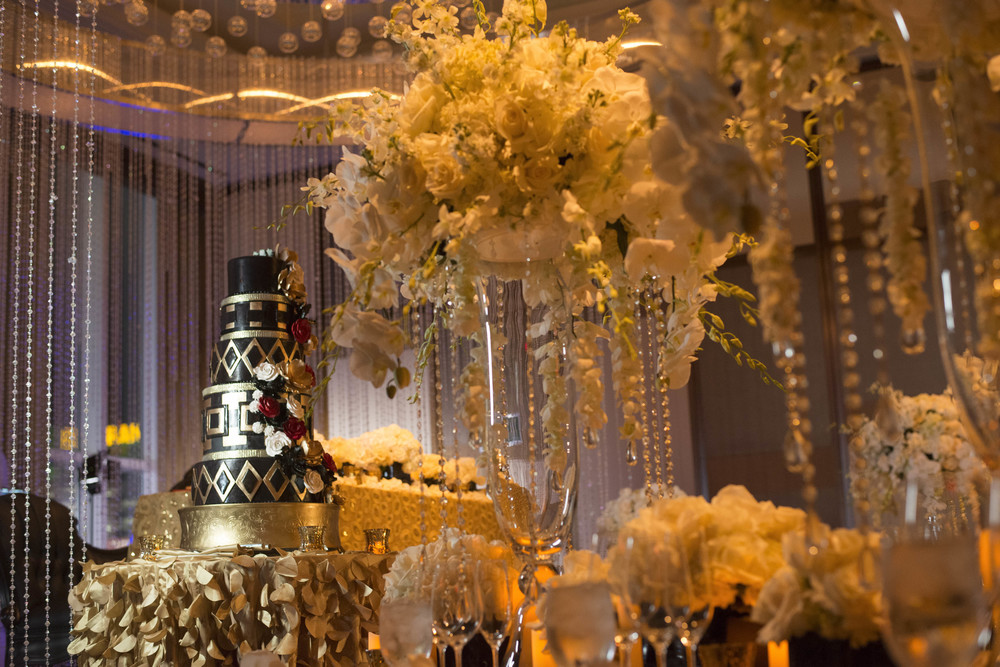 Amazing wedding cake in Great Gatsby old hollywood wedding.  Gold wedding.   Credits:  Wedding Planning and Event Design by  Andrea Eppolito Events  Luxury Las Vegas Wedding held at  The Mandarin Oriental .  Florals and Decor handled by  Destinations by Design .  Photography by  AltF Photography .  Wedding Film and Videography by  Pure Light Creative  with Music and Entertainment by  Mike Fox & Company .  Hair and Make Up by  Your Beauty Call .  Photo Booth and Video Screen by  The Joy Squad .    Stationery by  Laura Damiano Designs .