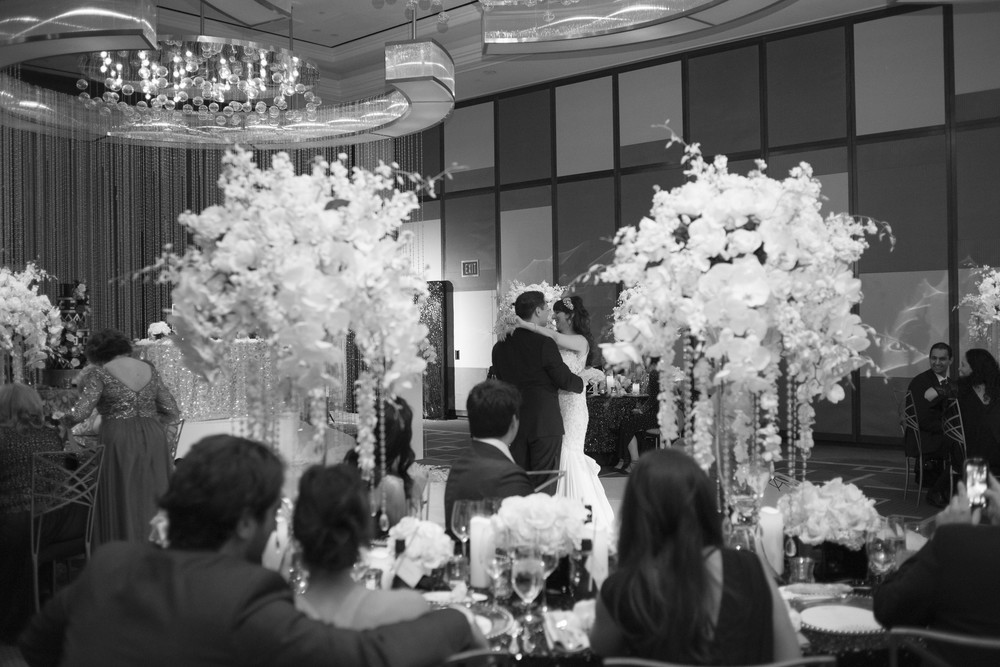 First dance black and white photography.  Credits:  Wedding Planning and Event Design by  Andrea Eppolito Events  Luxury Las Vegas Wedding held at  The Mandarin Oriental .  Florals and Decor handled by  Destinations by Design .  Photography by  AltF Photography .  Wedding Film and Videography by  Pure Light Creative  with Music and Entertainment by  Mike Fox & Company .  Hair and Make Up by  Your Beauty Call .  Photo Booth and Video Screen by  The Joy Squad .    Stationery by  Laura Damiano Designs .