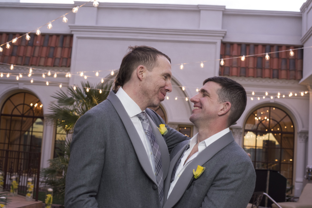 Newlyweds Brian Sauls and Chris Mancini at their same-sex wedding in Las Vegas.  The vintage Vegas themed event was hosted in the Verona Suite of The Westgate.    Venue -   The Westgate    |    Las Vegas Wedding Planner & Event Design by   Andrea Eppolito    |    Photography by   AltF Photography    |    Videography by   Something New Films    |    Floral and Decor by   DBD Vegas    |    Live Art by   The Girl Who Drew You    |    Stationery by   Paper & Home