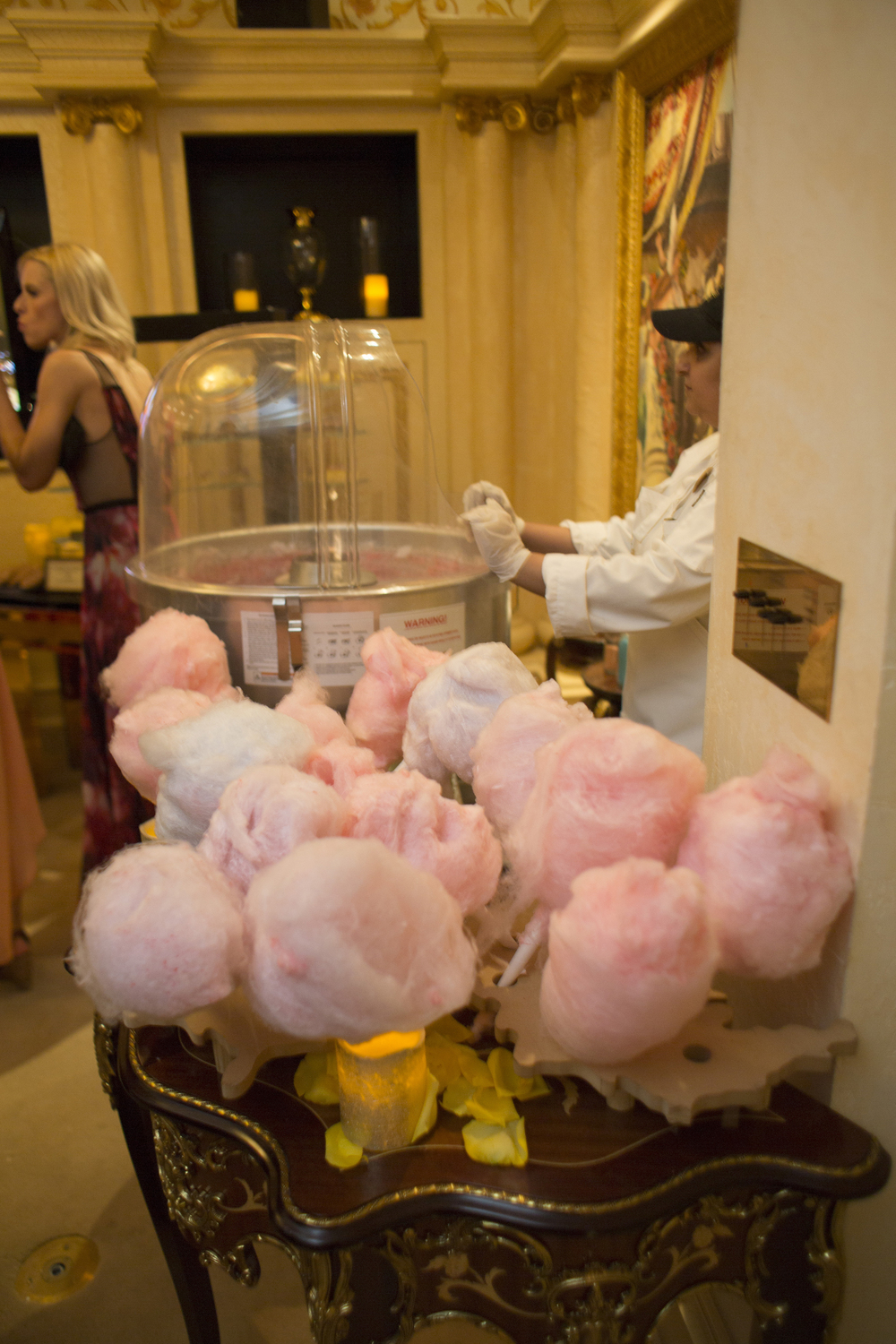 Cotton Candy is always a late night hit!   ewlyweds Brian Sauls and Chris Mancini at their same-sex wedding in Las Vegas.  The vintage Vegas themed event was hosted in the Verona Suite of The Westgate.   Venue -  The Westgate   |  Las Vegas Wedding Planner & Event Design by  Andrea Eppolito   |  Photography by  AltF Photography   |  Videography by  Something New Films   |  Floral and Decor by  DBD Vegas   |  Live Art by  The Girl Who Drew You   |  Stationery by  Paper & Home