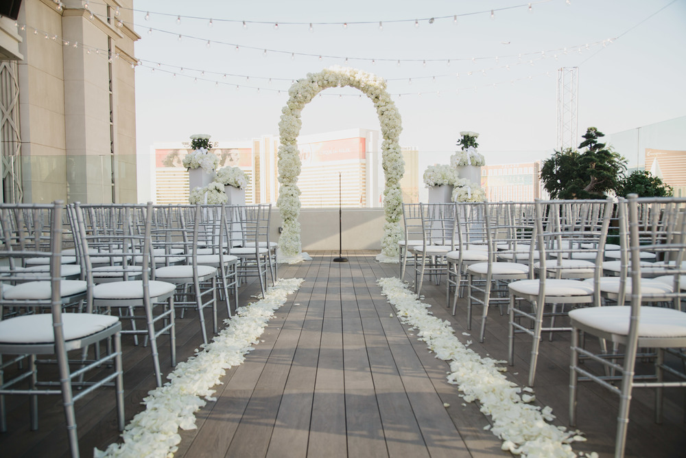 Wedding Ceremony on the patio of the Nobu Villa.  Vendor Credits:  Wedding in the  Nobu Villa   |  Las Vegas Wedding Planner  Andrea Eppolito    |  Photography by  Adam Frazier   |  Videography by  Pure Light Creative   |  Floral and Decor by  Destinations by Design   |  Lighting by LED Unplugged  |  Music by  DJ Mike Fox