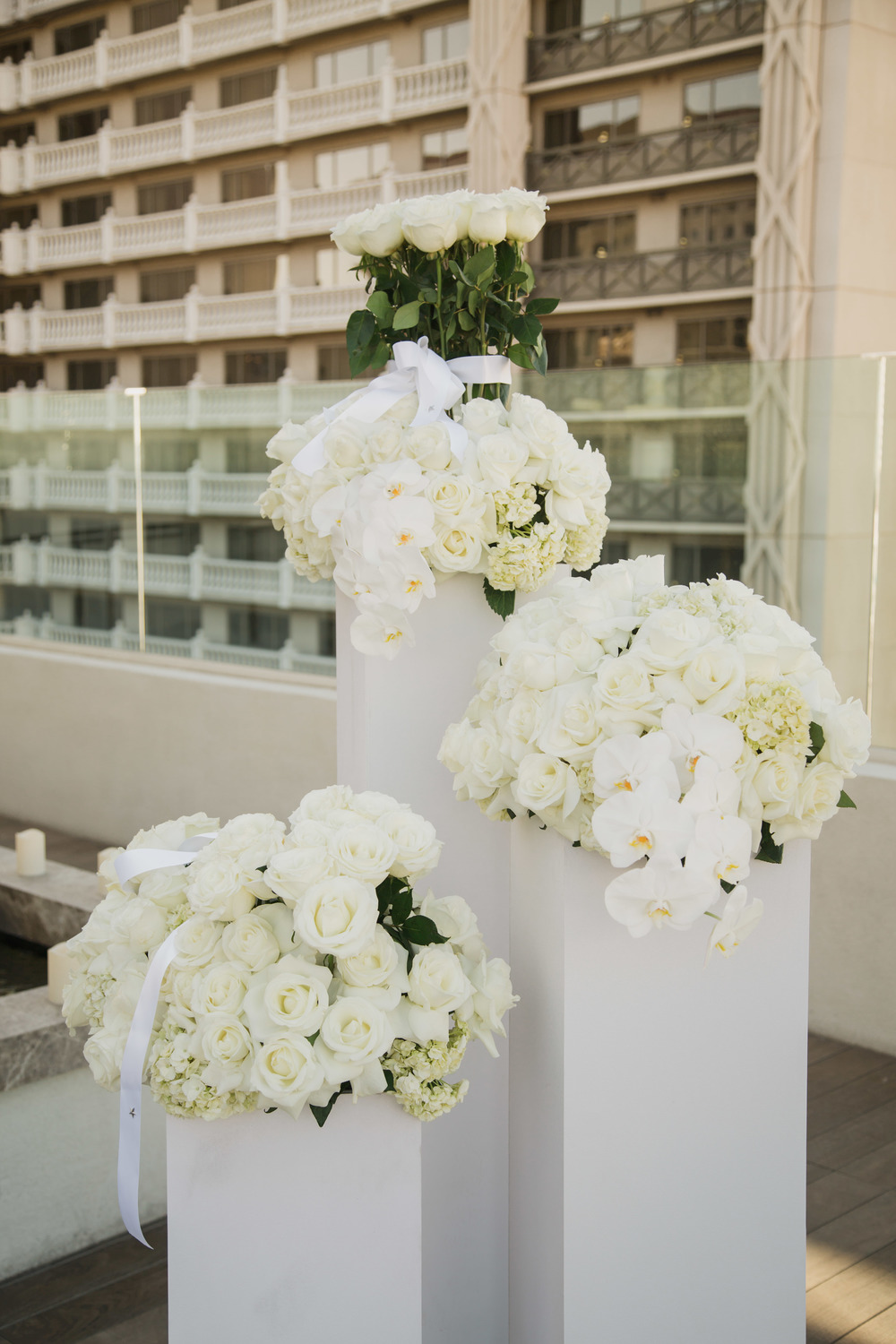Gorgeous white on white wedding centerpieces. Vendor Credits:  Wedding in the  Nobu Villa   |  Las Vegas Wedding Planner  Andrea Eppolito    |  Photography by  Adam Frazier   |  Videography by  Pure Light Creative   |  Floral and Decor by  Destinations by Design   |  Lighting by LED Unplugged  |  Music by  DJ Mike Fox