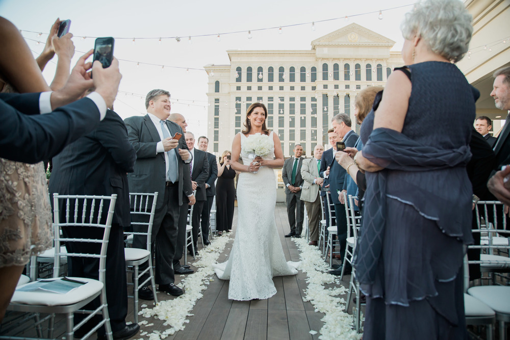 Here comes the bride in Las Vegas!   Vendor Credits:    Wedding in the   Nobu Villa    |    Las Vegas Wedding Planner   Andrea Eppolito     |    Photography by   Adam Frazier    |    Videography by   Pure Light Creative    |    Floral and Decor by   Destinations by Design    |  Lighting by LED Unplugged  |    Music by   DJ Mike Fox