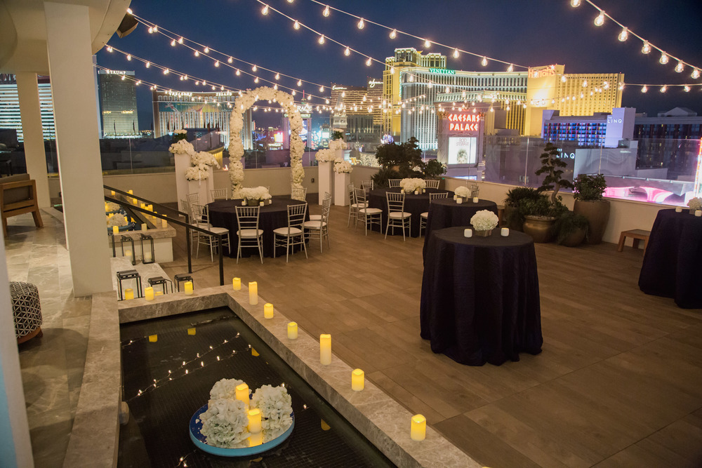The patio of the Nobu Villa transformed for a wedding reception.  Vendor Credits:    Wedding in the   Nobu Villa    |    Las Vegas Wedding Planner   Andrea Eppolito     |    Photography by   Adam Frazier    |    Videography by   Pure Light Creative    |    Floral and Decor by   Destinations by Design    |  Lighting by LED Unplugged  |    Music by   DJ Mike Fox