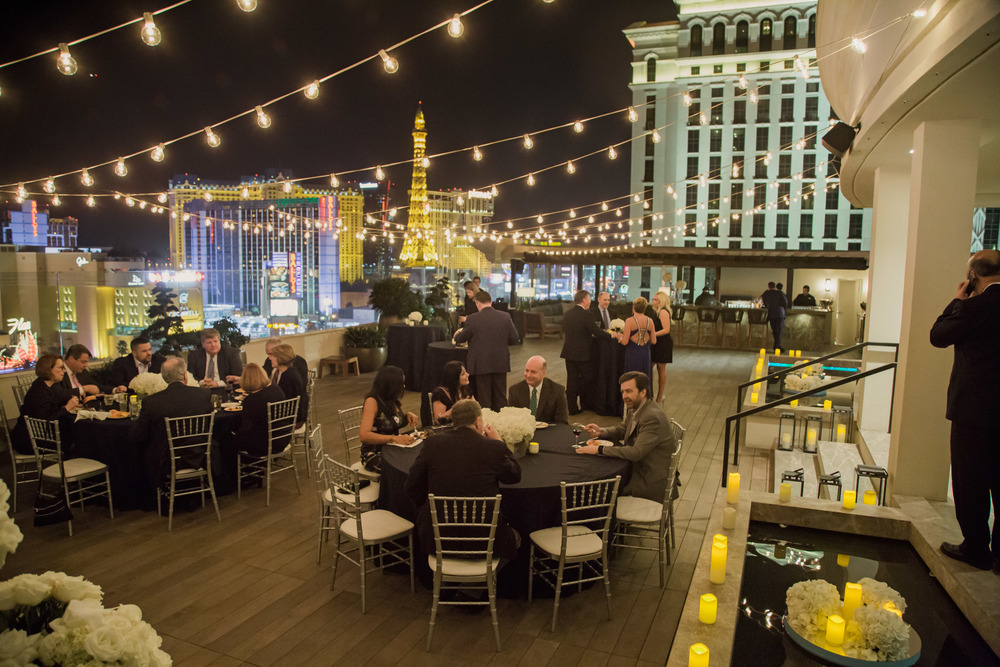 Dinner al fresca.  Rooftop wedding dinner.   Vendor Credits:    Wedding in the   Nobu Villa    |    Las Vegas Wedding Planner   Andrea Eppolito     |    Photography by   Adam Frazier    |    Videography by   Pure Light Creative    |    Floral and Decor by   Destinations by Design    |  Lighting by LED Unplugged  |    Music by   DJ Mike Fox
