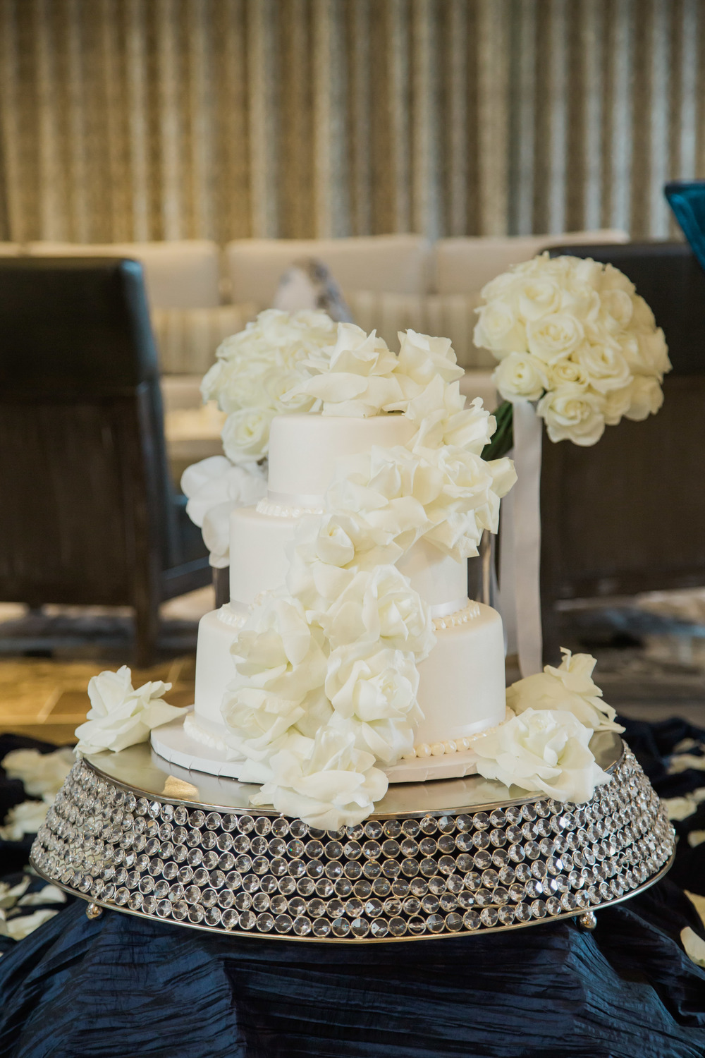 White on white wedding cake by Caesars Palace .   Vendor Credits:    Wedding in the   Nobu Villa    |    Las Vegas Wedding Planner   Andrea Eppolito     |    Photography by   Adam Frazier    |    Videography by   Pure Light Creative    |    Floral and Decor by   Destinations by Design    |  Lighting by LED Unplugged  |    Music by   DJ Mike Fox