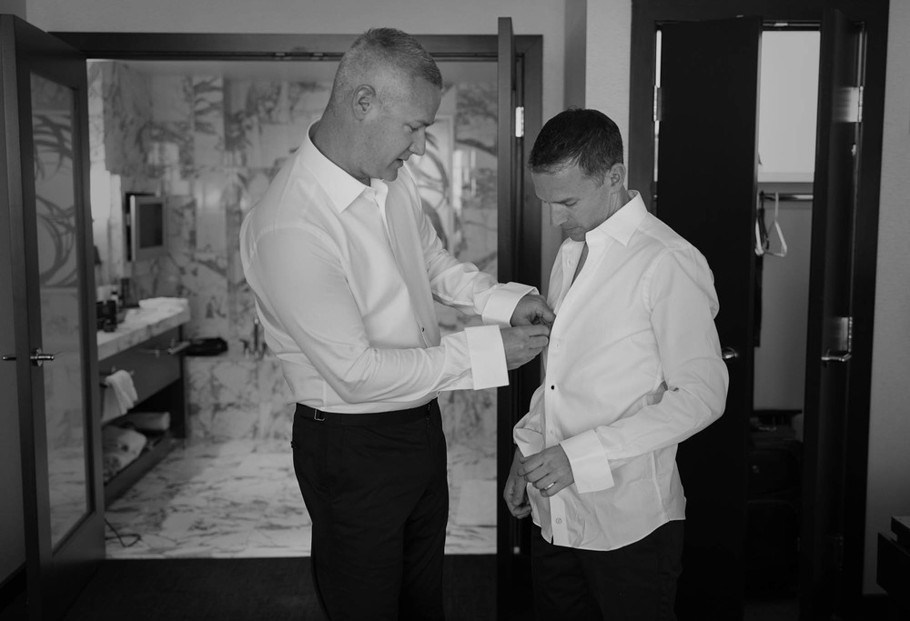 Grooms Fletcher and Greg getting ready together.  Gay Wedding at Red Rock Resort by Las Vegas Wedding Planner Andrea Eppolito.  Images by Altf Photography.  Florals and decor by Destinations by Design.  Two grooms at a gay wedding in Las Vegas.