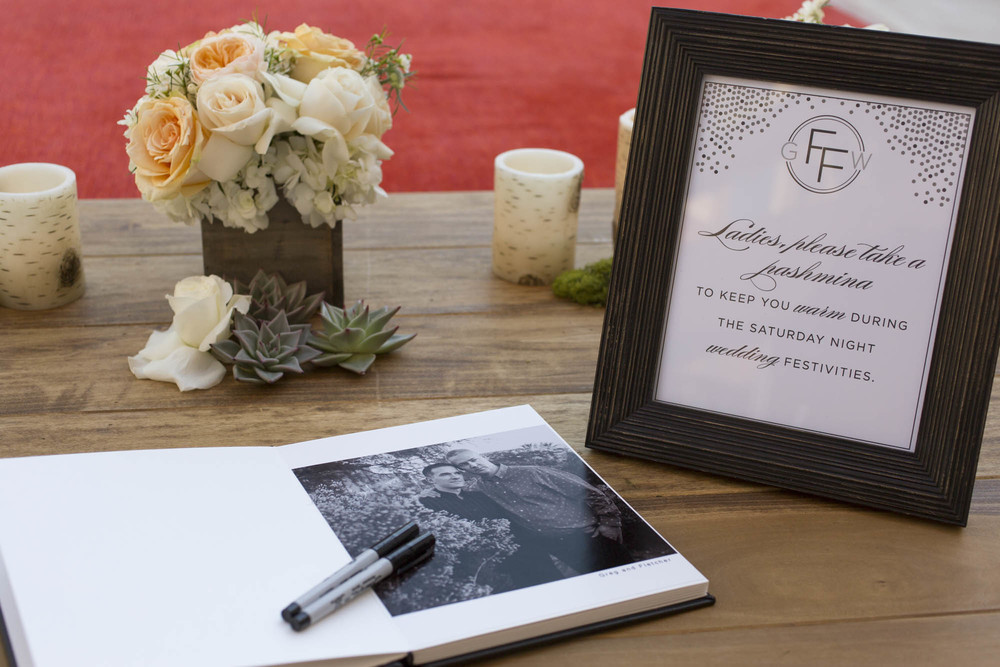 Engagement photo sign in book. Gay Wedding at Red Rock Resort by Las Vegas Wedding Planner Andrea Eppolito.  Images by Altf Photography.  Florals and decor by Destinations by Design.  Two grooms at a gay wedding in Las Vegas.
