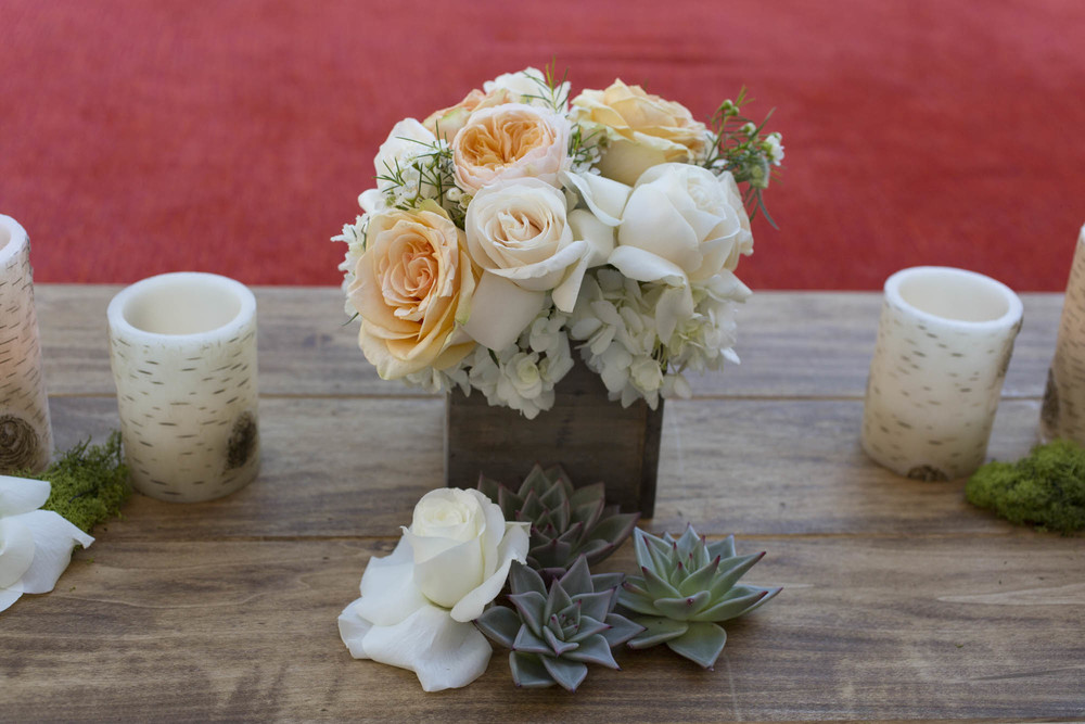 Small succulent and rose accent pieces on the sign in table.  Gay Wedding at Red Rock Resort by Las Vegas Wedding Planner Andrea Eppolito.  Images by Altf Photography.  Florals and decor by Destinations by Design.  Two grooms at a gay wedding in Las Vegas.