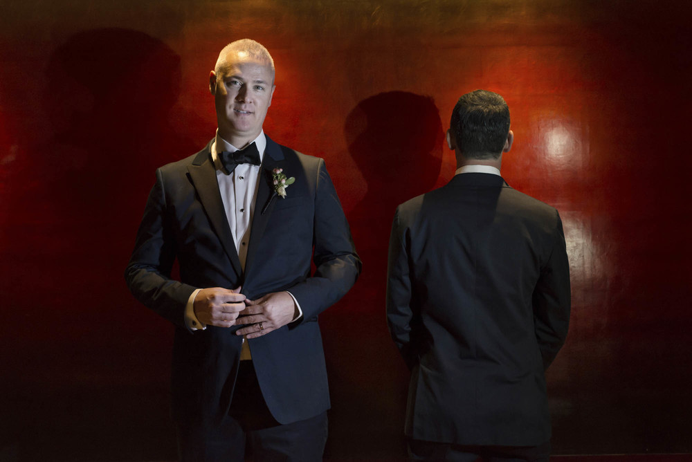 How to photograph two grooms. Gay Wedding at Red Rock Resort by Las Vegas Wedding Planner Andrea Eppolito.  Images by Altf Photography.  Florals and decor by Destinations by Design.  Two grooms at a gay wedding in Las Vegas.  How W