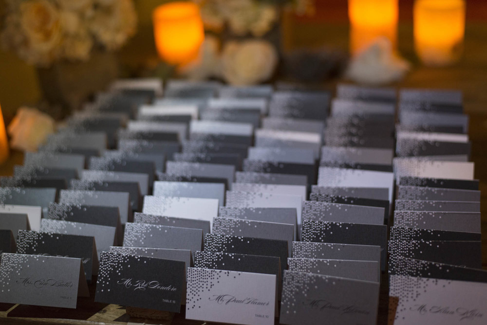 Multicolored grey escort cards. Gay Wedding at Red Rock Resort by Las Vegas Wedding Planner Andrea Eppolito.  Images by Altf Photography.  Florals and decor by Destinations by Design.  Two grooms at a gay wedding in Las Vegas.