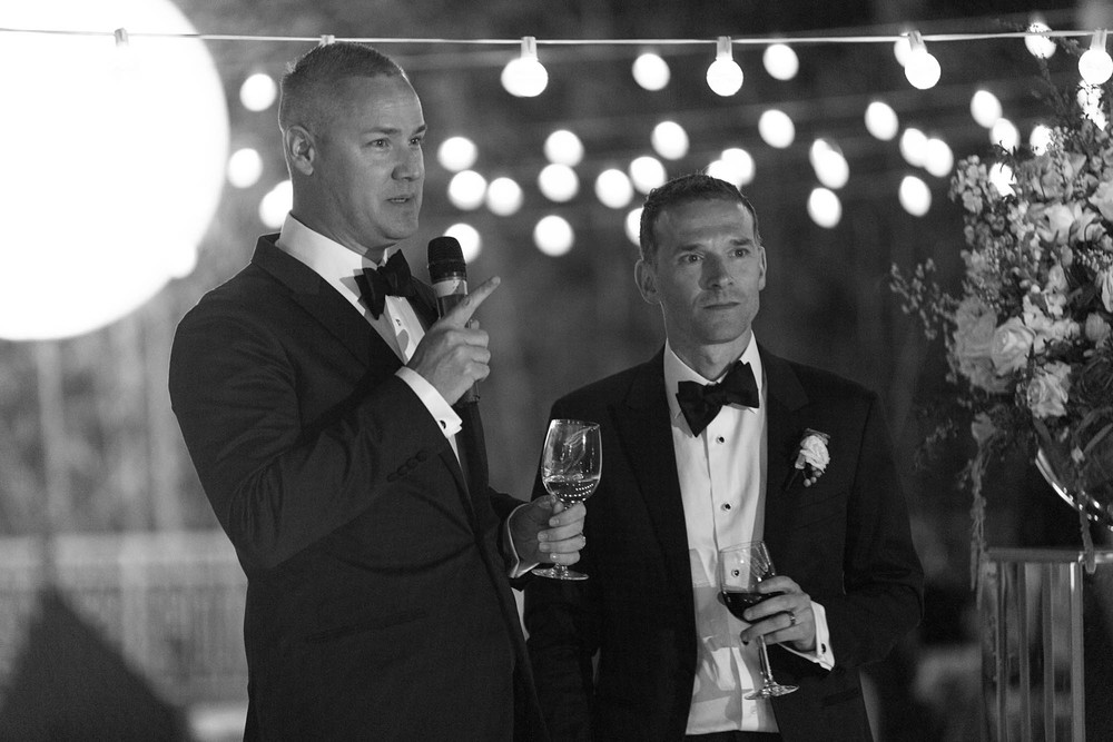 A thank you speech from the grooms. Gay Wedding at Red Rock Resort by Las Vegas Wedding Planner Andrea Eppolito.  Images by Altf Photography.  Florals and decor by Destinations by Design.  Two grooms at a gay wedding in Las Vegas.  T
