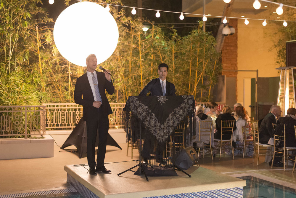 More live performances with friends singing for the wedding. Gay Wedding at Red Rock Resort by Las Vegas Wedding Planner Andrea Eppolito.  Images by Altf Photography.  Florals and decor by Destinations by Design.  Two grooms at a gay wedding in Las Vegas.