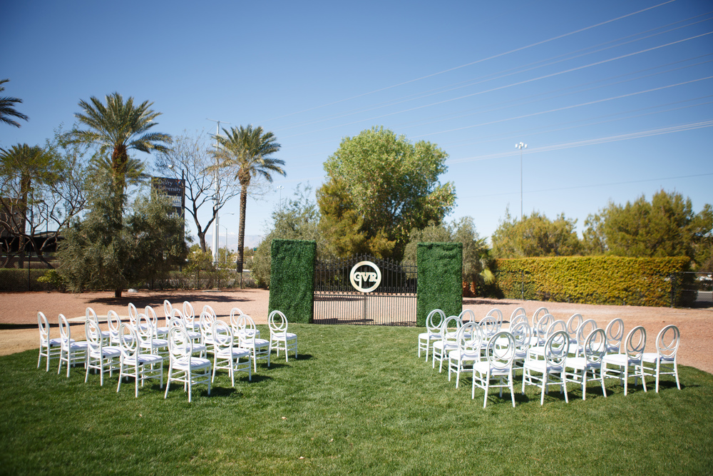 A monogrammed gate served as the backdrop to the mock wedding ceremony on the lawn.