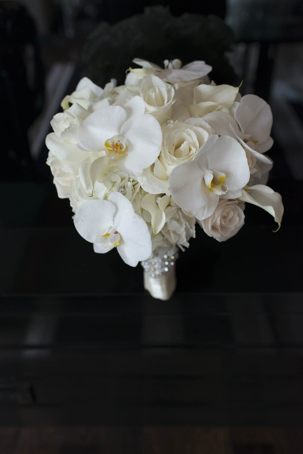 White Bridal Bouquet with orchids, hydrangea, and roses.   CREATIVE PARTNERS: PHOTOGRAPHY • AltF Photography, PLANNING • Andrea Eppolito Events, FLORAL AND DECOR DESIGN •Destinations by Design, VENUE AND CATERING • Mandarin Oriental, Las Vegas, STATIONERY DESIGN • Paper and Home, BRIDE'S GOWN • Vera Wang, SHOES • Jimmy Choo, GROOM'S FORMAL WEAR • Vera Wang, ENGAGEMENT RING • Delage Jewelers, WEDDING BANDS • T-Birds Jewels, CAKE DESIGN • Mandarin Oriental Las Vegas, DRAPING; DANCE FLOOR DESIGN AND PRODUCTION • Destination by Design, LIVE EVENT ARTIST • Sam Day, ENTERTAINMENT • Lucky Devils Band, CINEMATOGRAPHY • Something New