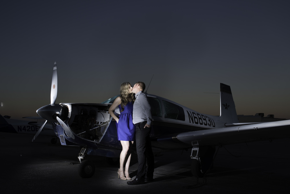 Destination Wedding Planner Andrea Eppolito | Engagement Photos in an Airplane Hanger | Images by AltF Photography