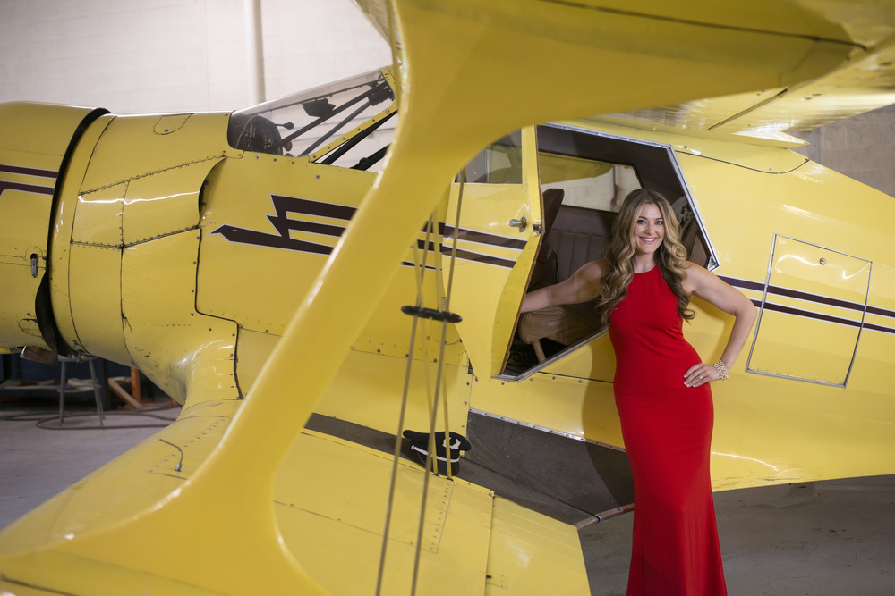 Destination Wedding Planner Andrea Eppolito | Engagement Photos in an Airplane Hanger | Images by AltF Photography | Long red dress by Rent the Runway