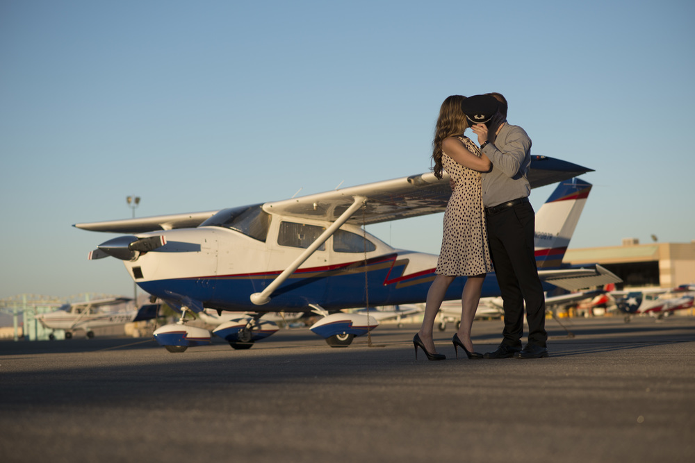 Destination Wedding Planner Andrea Eppolito | Engagement Photos in an Airplane Hanger | Images by AltF Photography |