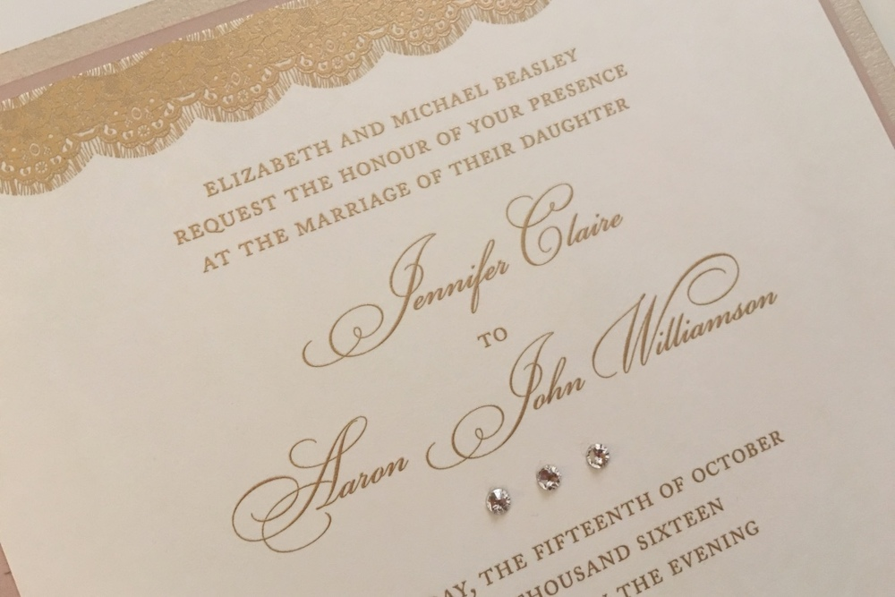 Lace and crystal accents on wedding invitation by Shop Annabelles.