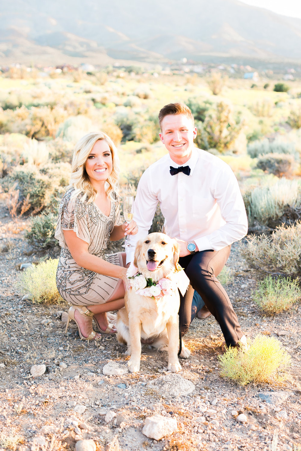 Family photo with dog at engagement and proposal session.