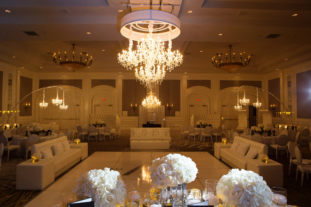 Candlelit wedding with chandeliers on arcs.   Four Seasons Wedding by Las Vegas Wedding Planner Andrea Eppolito.  Image by AltF Photography.  Decor by DBD Vegas.