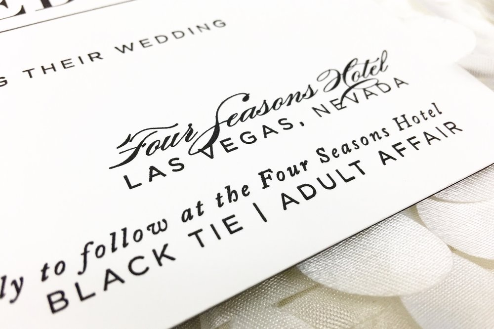 Invitations by Paper & Home.  Four Seasons Wedding by Las Vegas Wedding Planner Andrea Eppolito.  Decor by DBD Vegas.