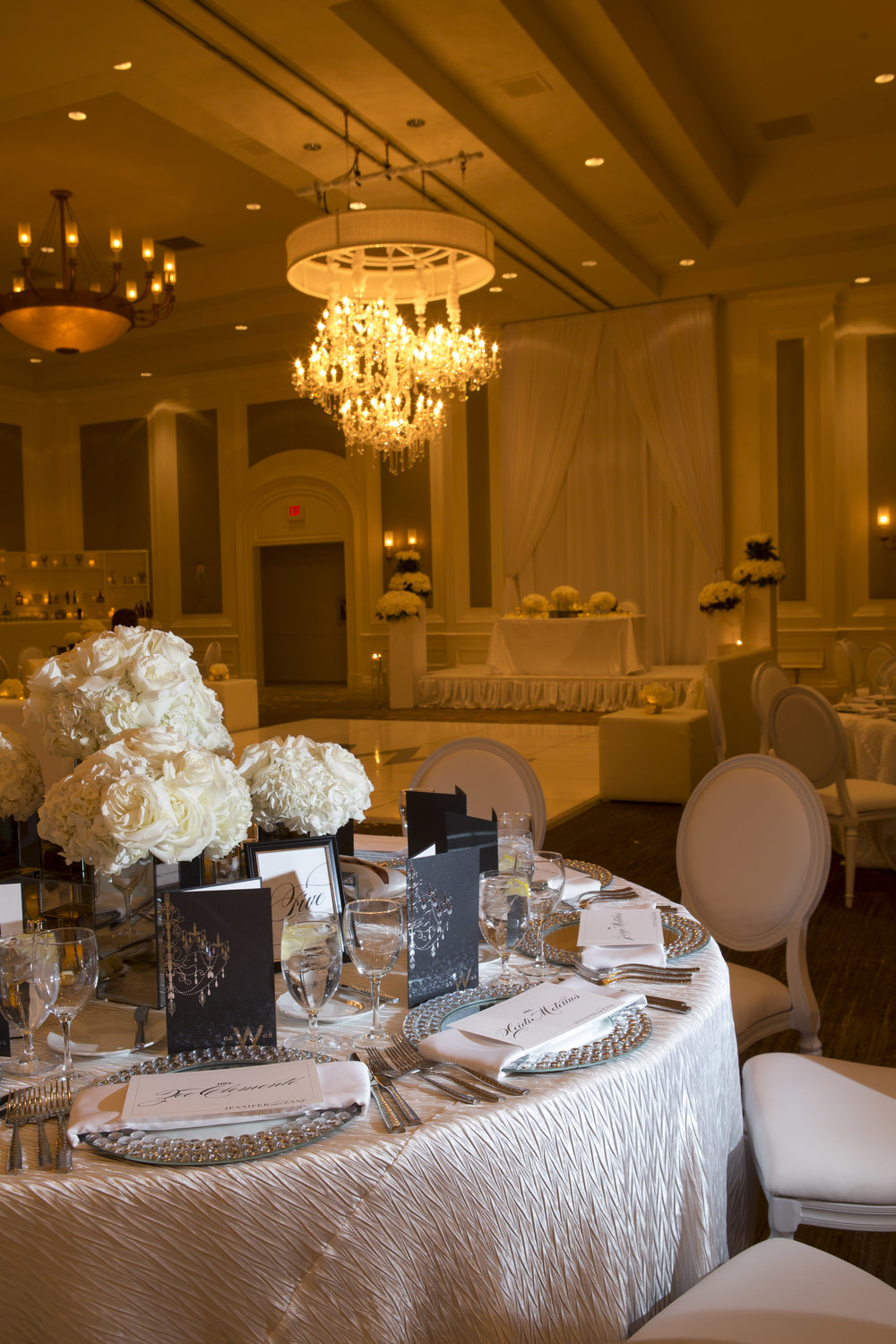 White on white wedding reception with custom steakhouse menus.  Four Seasons Wedding by Las Vegas Wedding Planner Andrea Eppolito.  Image by AltF Photography.  Decor by DBD Vegas.