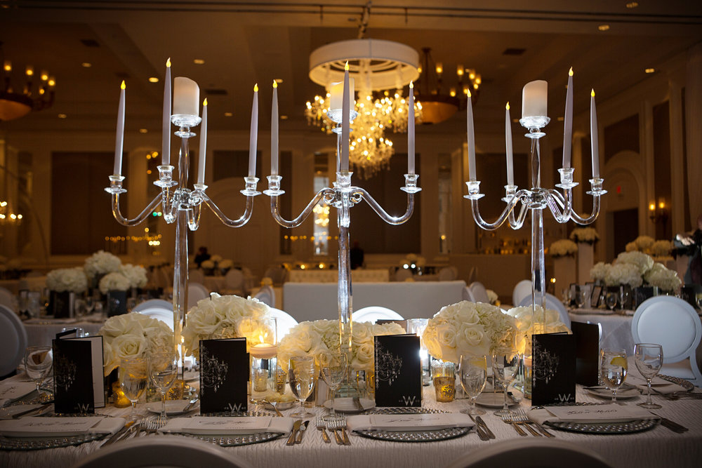 Candelabras at white on white wedding with black menus.    Four Seasons Wedding by Las Vegas Wedding Planner Andrea Eppolito.  Image by AltF Photography.  Decor by DBD Vegas.