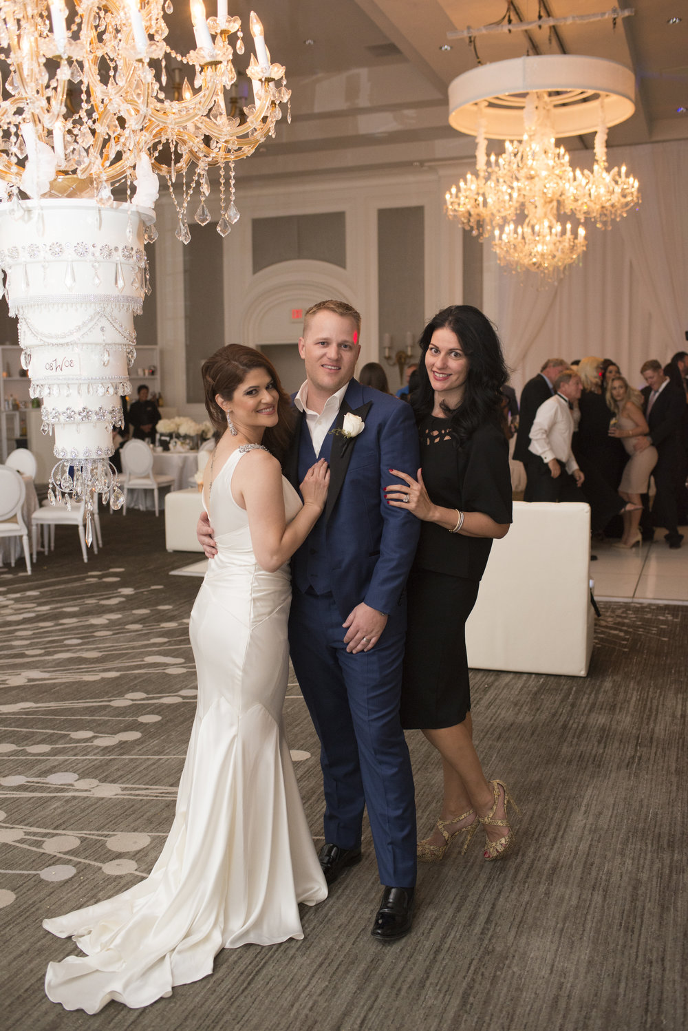 Luxury Las VegasWedding Planner Andrea Eppolito with bride Jennifer Hixson and groom Travis Zane Weber.