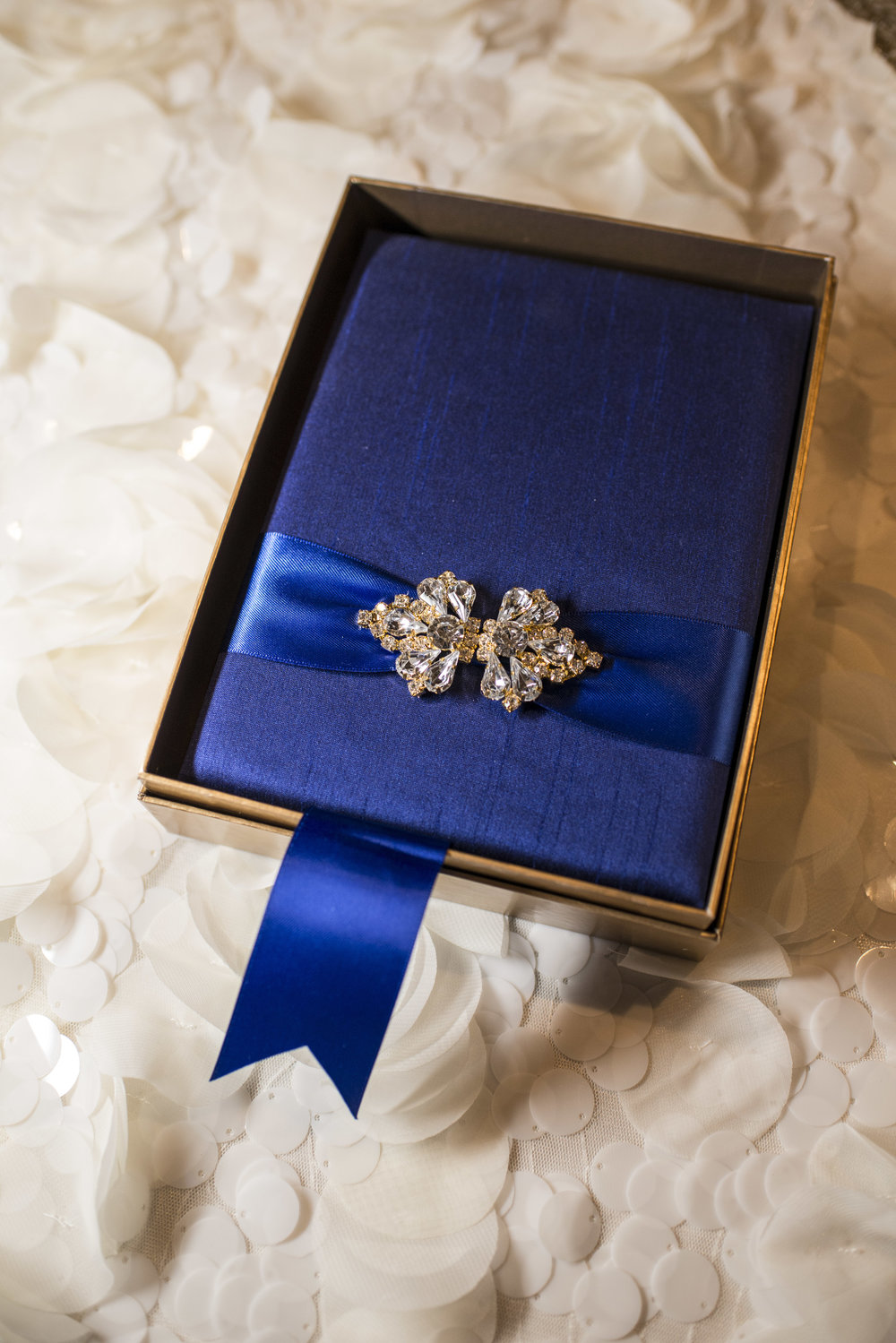 Royal Blue boxed invitation with jewel clasp by Paper and Home. Luxury Las Vegas Wedding Planner Andrea Eppolito.  Image by AltF Photography.
