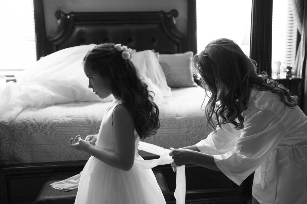 Bride getting dressed with her daughter. Luxury Las Vegas Wedding Planner Andrea Eppolito.  Image by AltF Photography.
