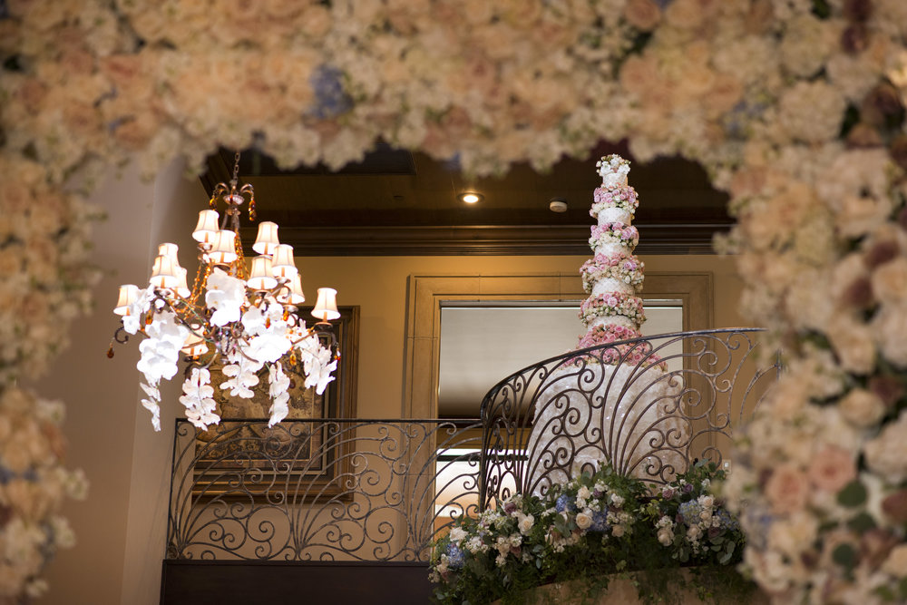 Towering wedding cake in Juliet Balcony. Luxury Las Vegas Wedding Planner Andrea Eppolito.  Image by AltF Photography.  Cake by Four Seasons Las Vegas.