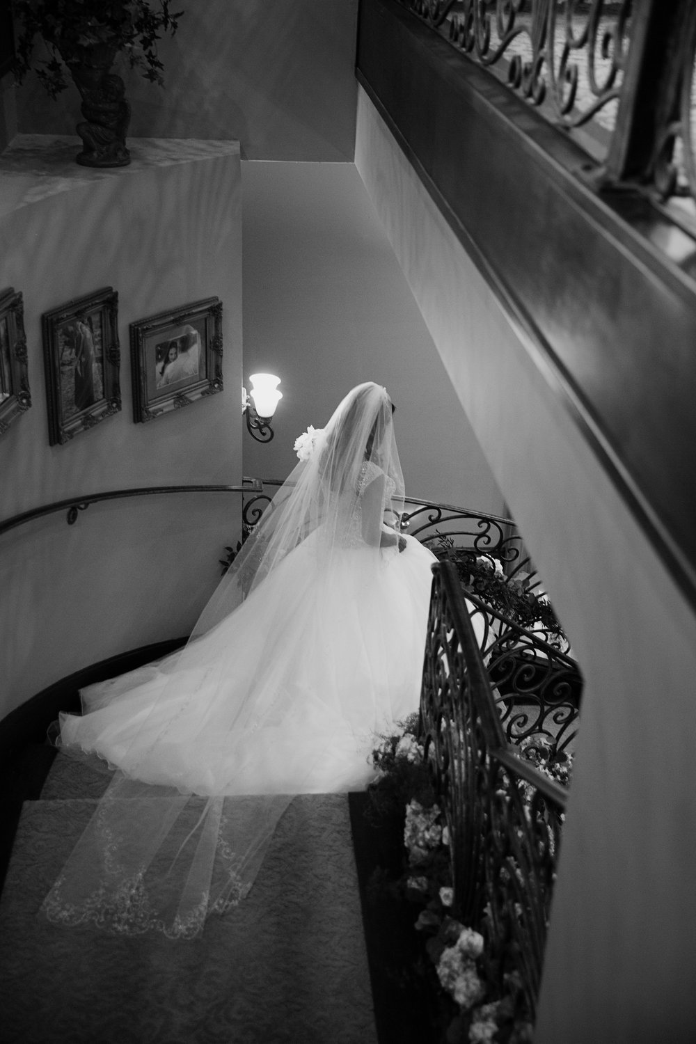 Bride goes down the staircase to meet her groom. Luxury Las Vegas Wedding Planner Andrea Eppolito.  Image by AltF Photography.